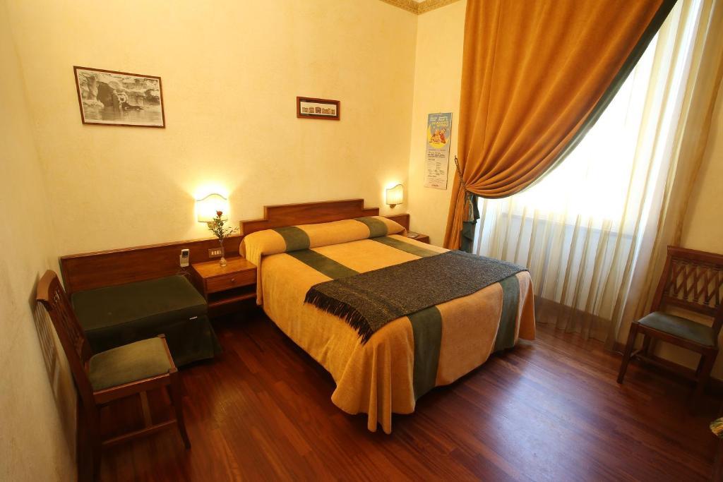 A bed or beds in a room at Al Colonnato di San Pietro