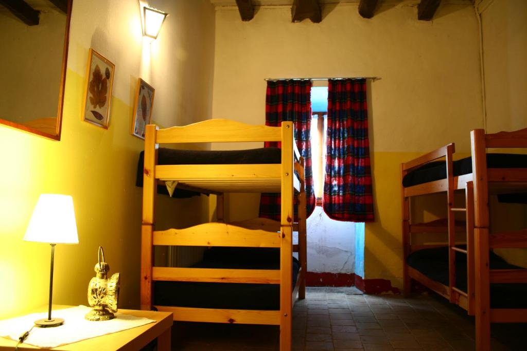 A bunk bed or bunk beds in a room at Can Vilalta