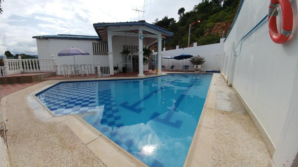Hotel Quinta Casa Blanca (Colombia Melgar) - Booking.com