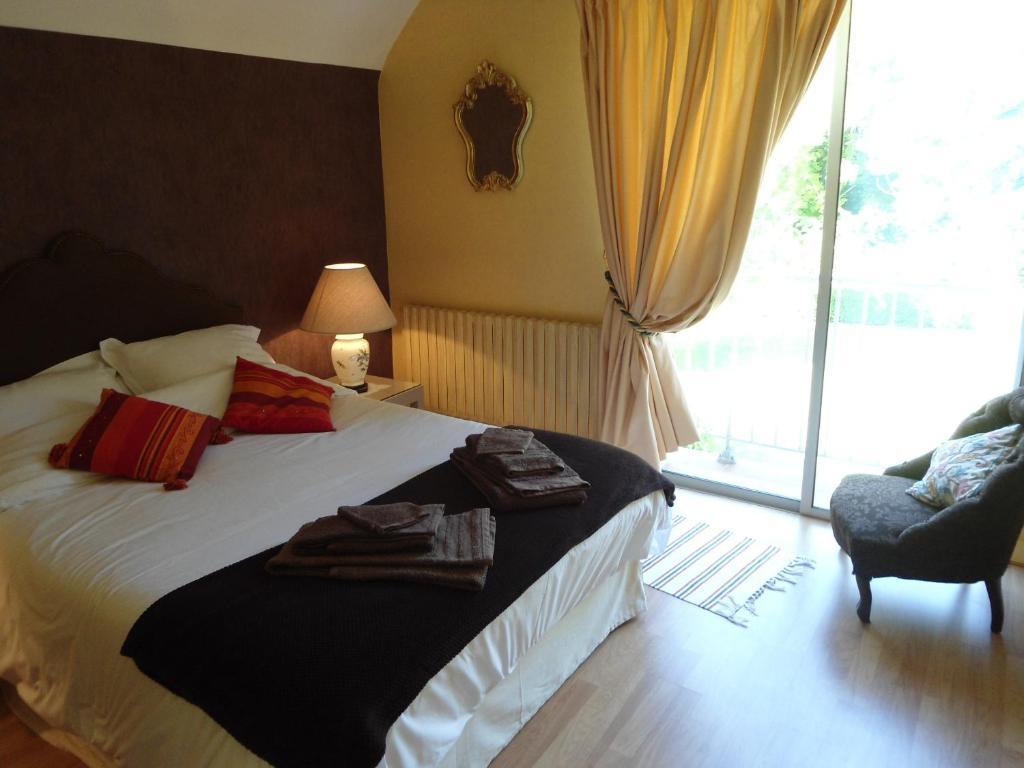 Un ou plusieurs lits dans un hébergement de l'établissement B&B La Maison de L'Aubette
