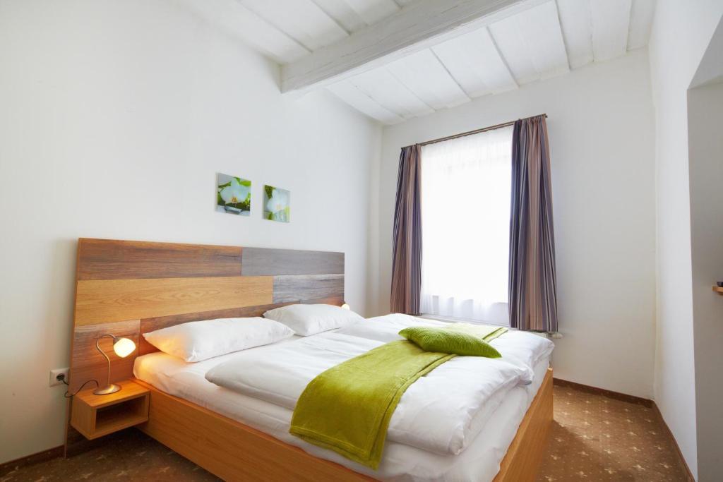 Ein Bett oder Betten in einem Zimmer der Unterkunft Rathauskeller Melk