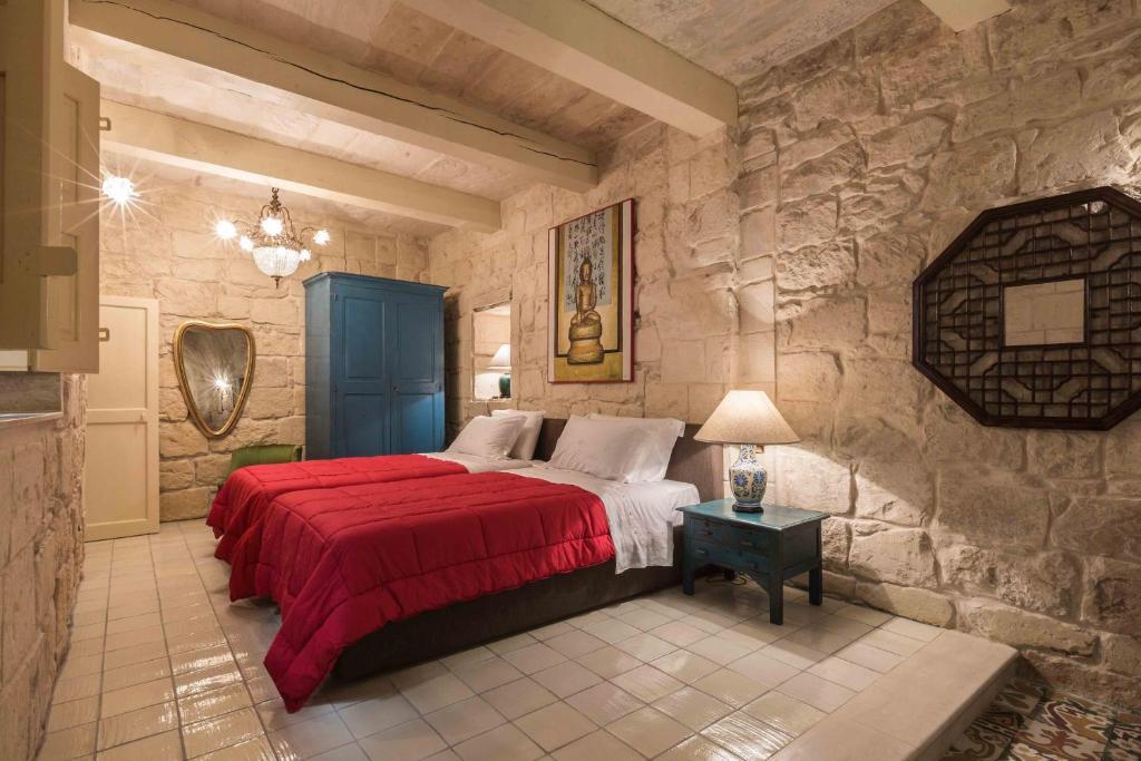 Un ou plusieurs lits dans un hébergement de l'établissement Locanda La Gelsomina