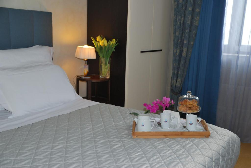 A bed or beds in a room at Domus Mariae Benessere