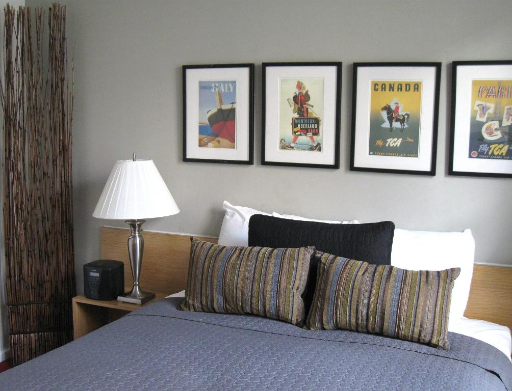 Cama ou camas em um quarto em Touchstone Hotel - City Center