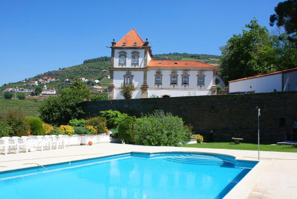 The swimming pool at or near Casa das Torres de Oliveira