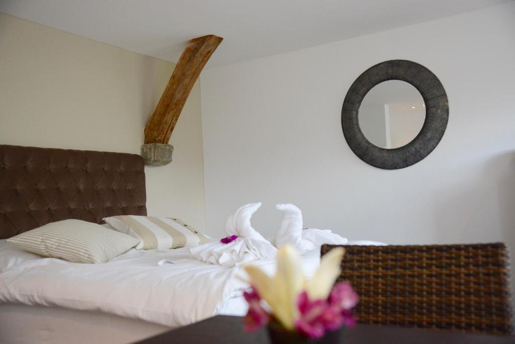 Ein Bett oder Betten in einem Zimmer der Unterkunft Seehaus Claire