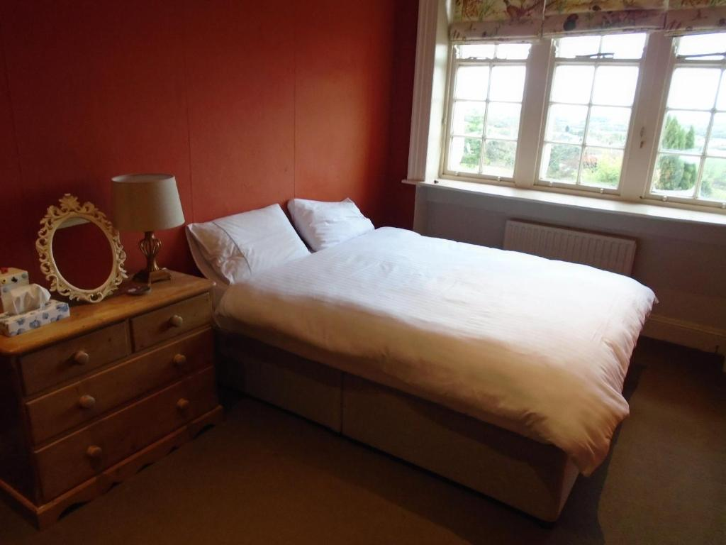 A bed or beds in a room at Ballynona House