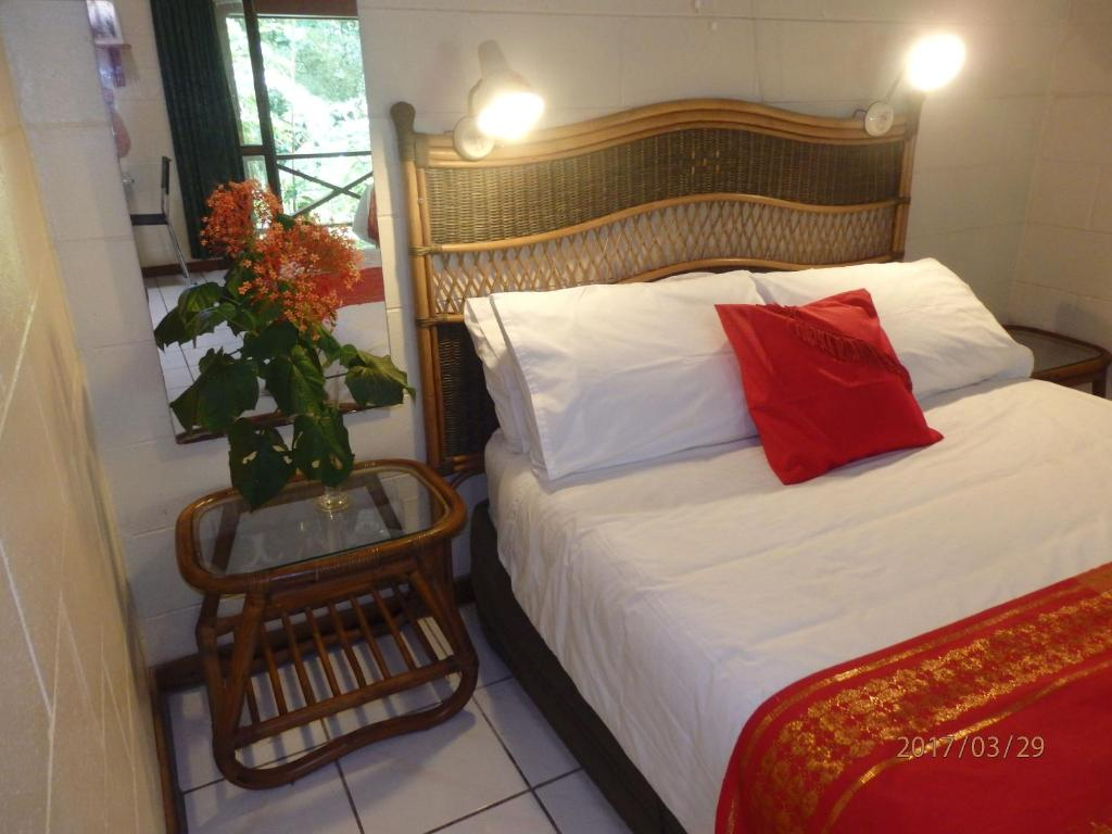 A bed or beds in a room at Daintree Deep Forest Lodge