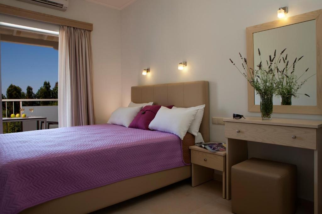 Ένα ή περισσότερα κρεβάτια σε δωμάτιο στο Savinos Rooms