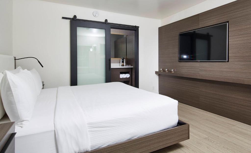 A bed or beds in a room at The Nest Hotel