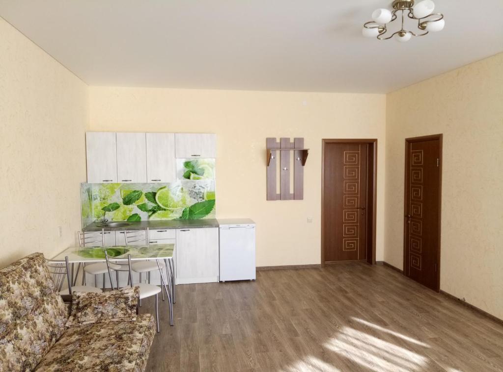 Кухня или мини-кухня в Гостевой дом на Видная 26