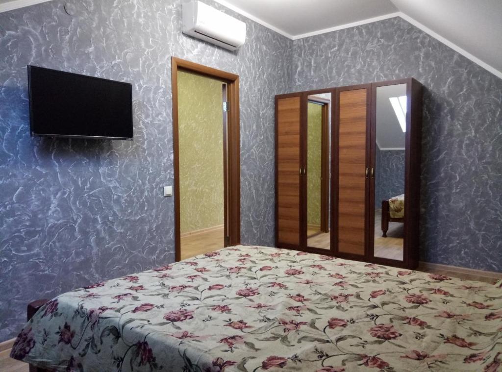 Кровать или кровати в номере Гостевой дом на Видная 26