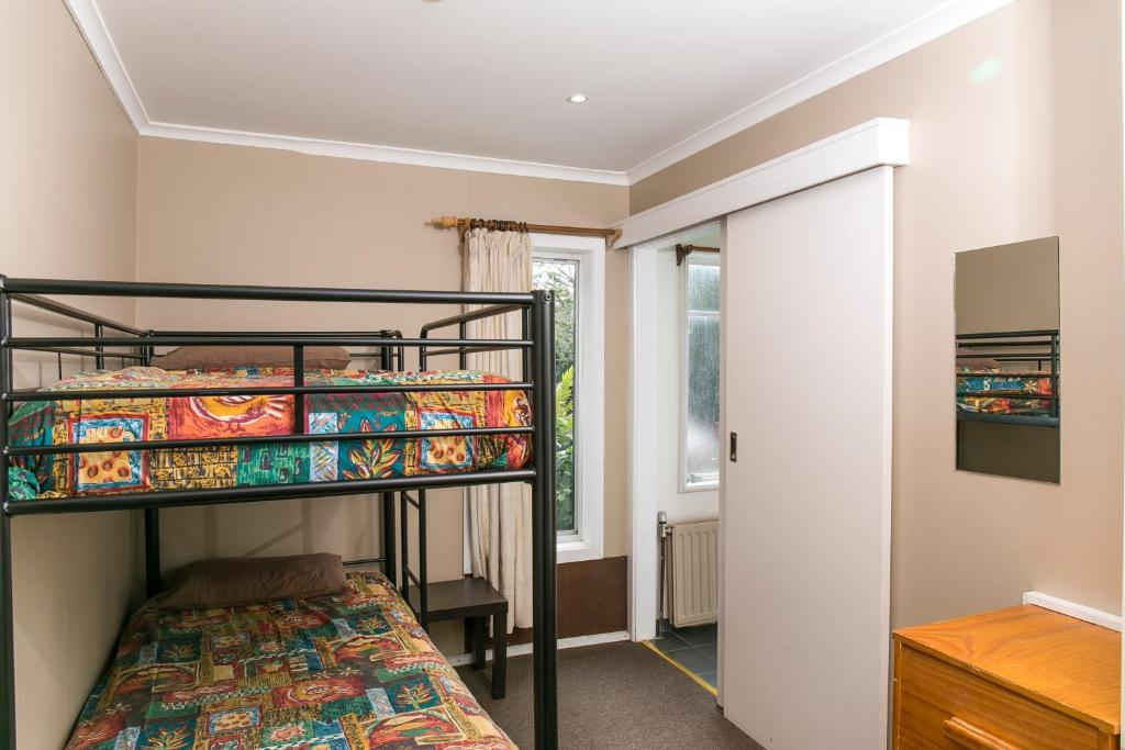 A bunk bed or bunk beds in a room at Halleys Lodge
