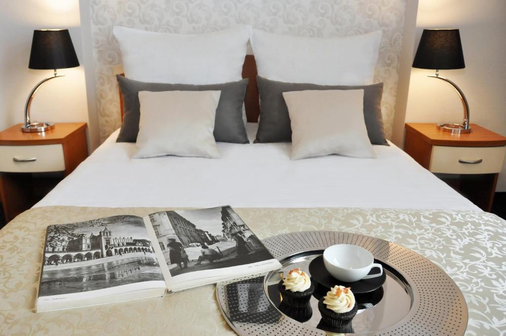 Lova arba lovos apgyvendinimo įstaigoje Hotel Atrium