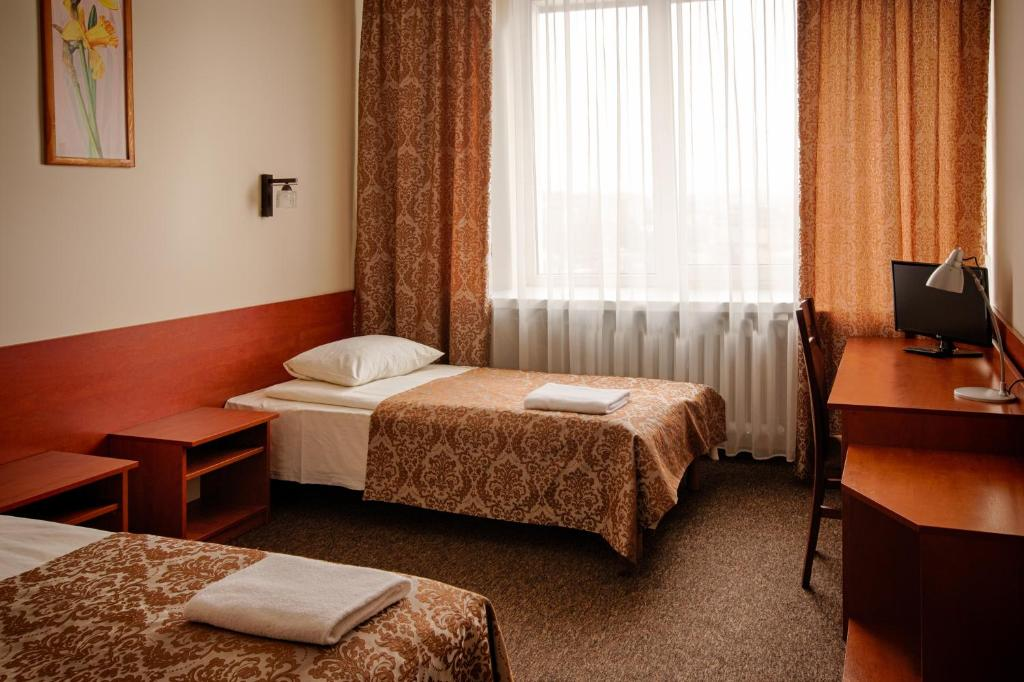 A bed or beds in a room at Turkus