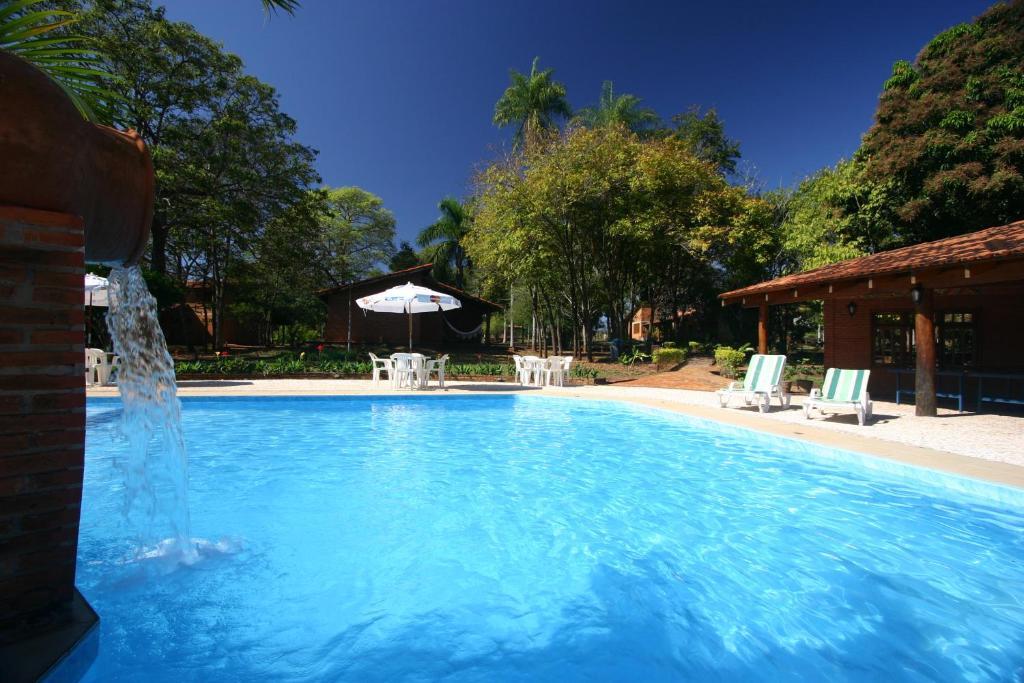 The swimming pool at or near Pousada Olho D'Água