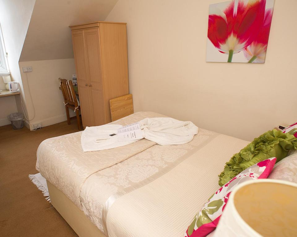 A bed or beds in a room at Craig Park House
