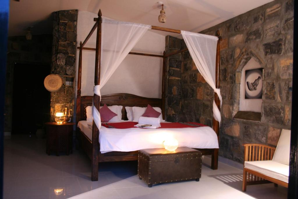 A bed or beds in a room at Sama Heights Resort