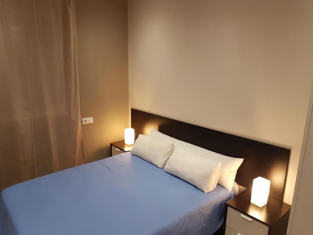 Cama ou camas em um quarto em Vivienda Reina Victoria