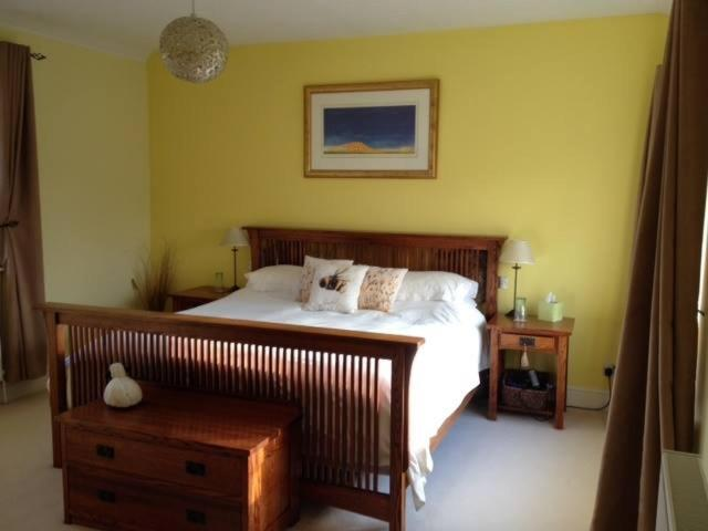 A bed or beds in a room at Grange Farm B & B