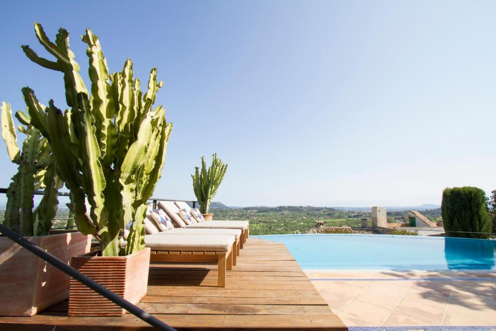 The swimming pool at or near Can Cota Boutique