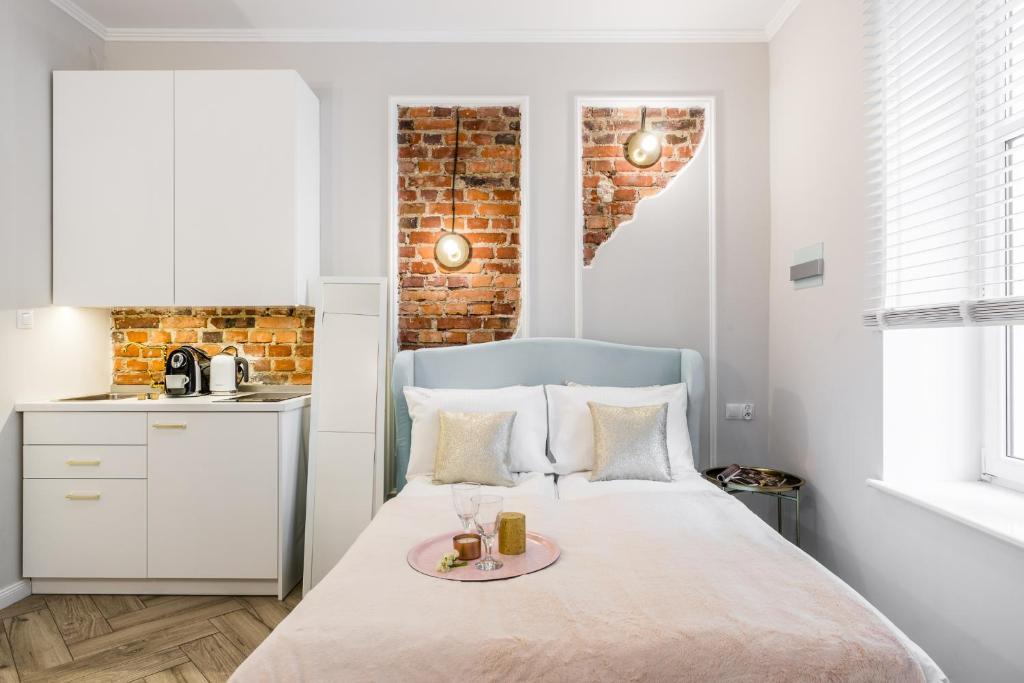 מיטה או מיטות בחדר ב-Apartments Factory