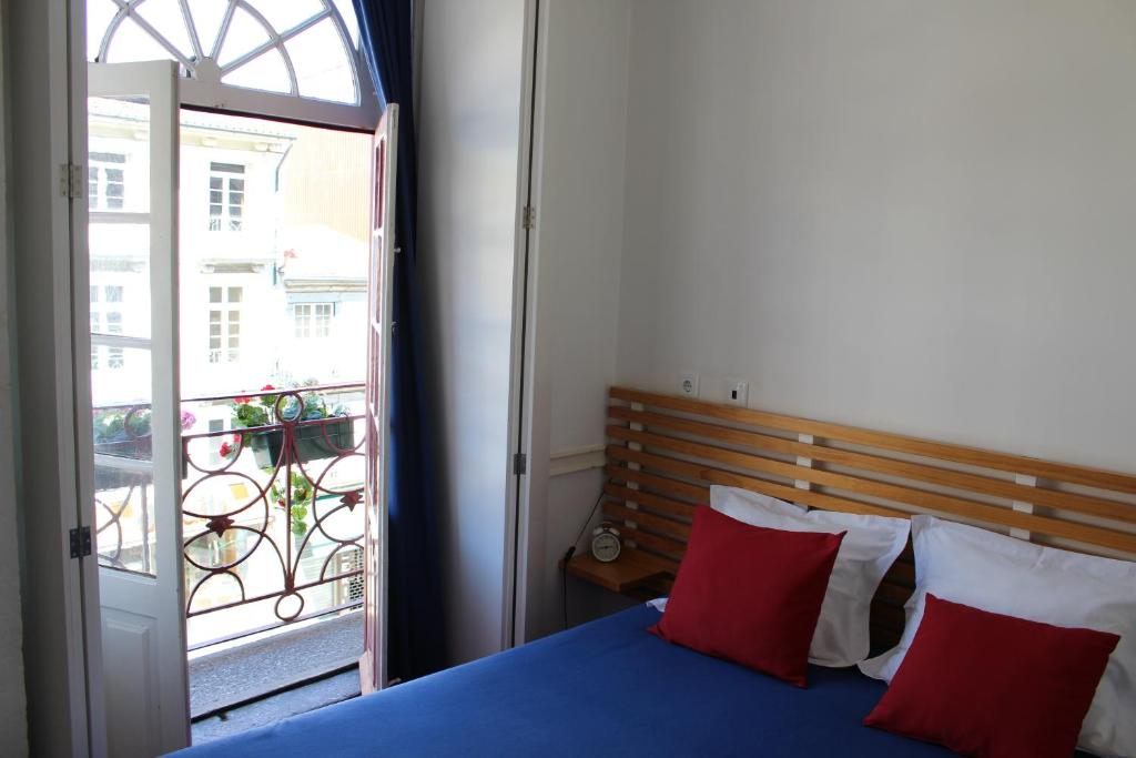 A bed or beds in a room at Linha 22