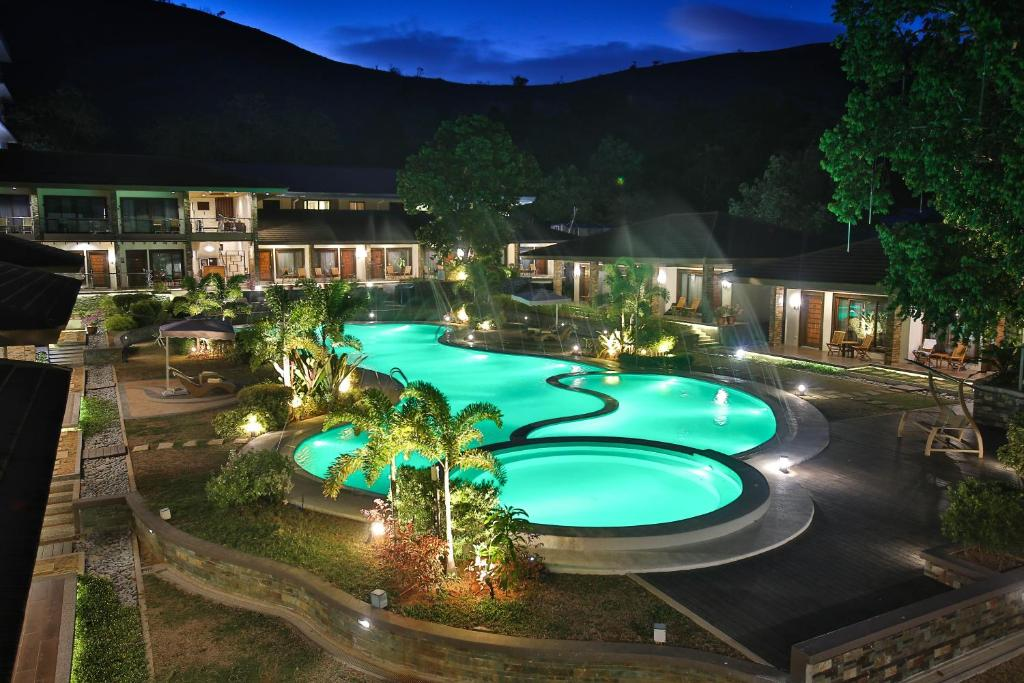 A view of the pool at Coron Soleil Garden Resort or nearby