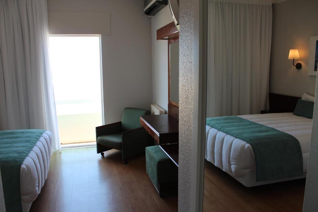 A bed or beds in a room at Costa de Prata II