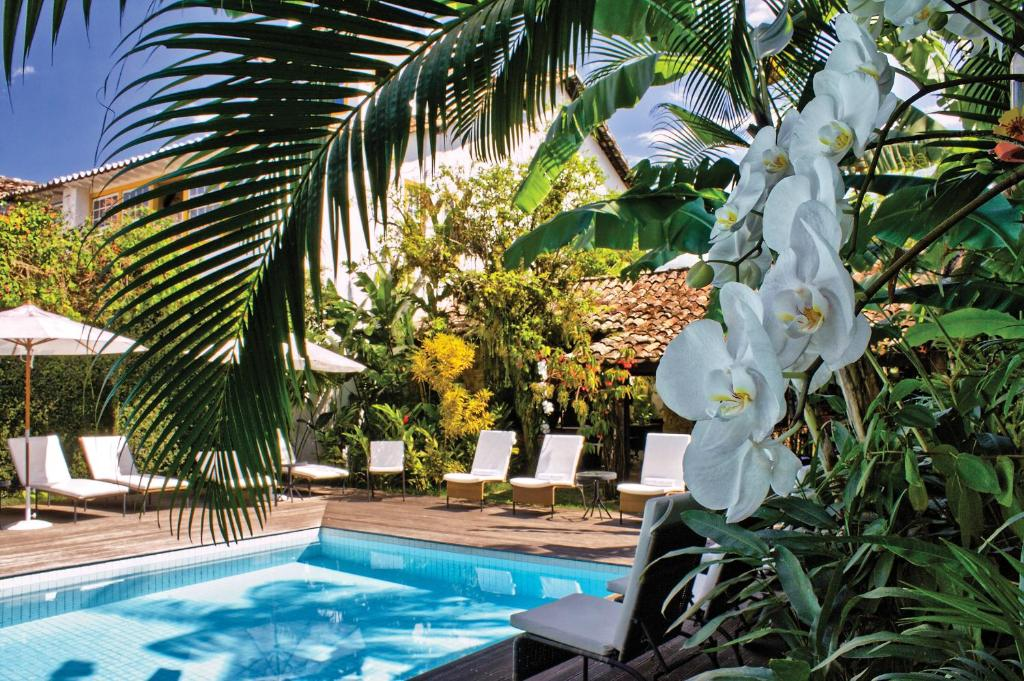 The swimming pool at or near Pousada do Ouro