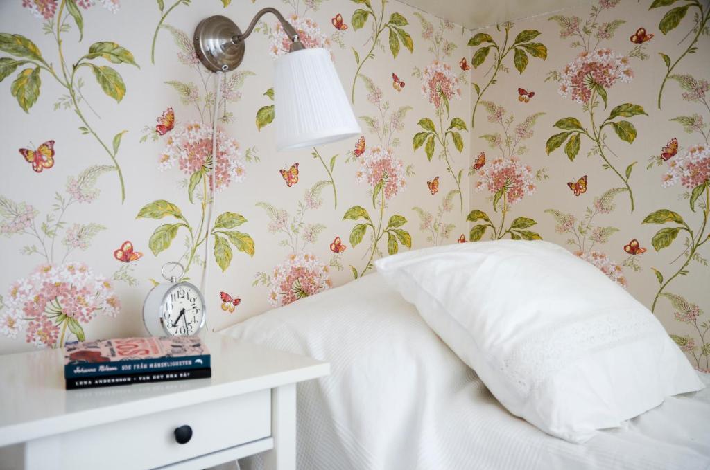 Säng eller sängar i ett rum på Stormyrbergets Lantgård