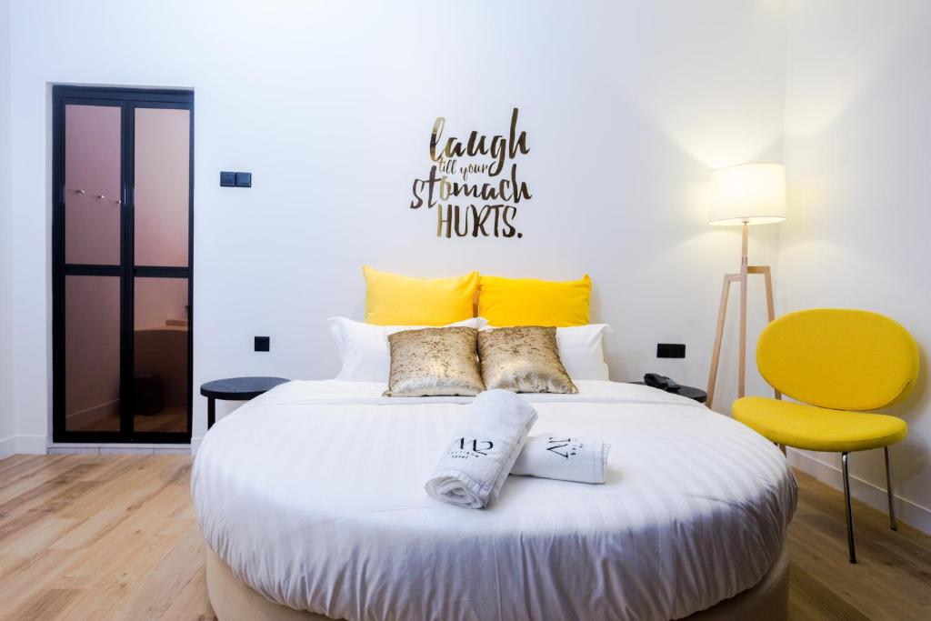 A bed or beds in a room at M2 BOUTIQUE HOTEL