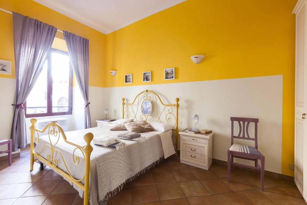 A bed or beds in a room at Trastevere Dream House