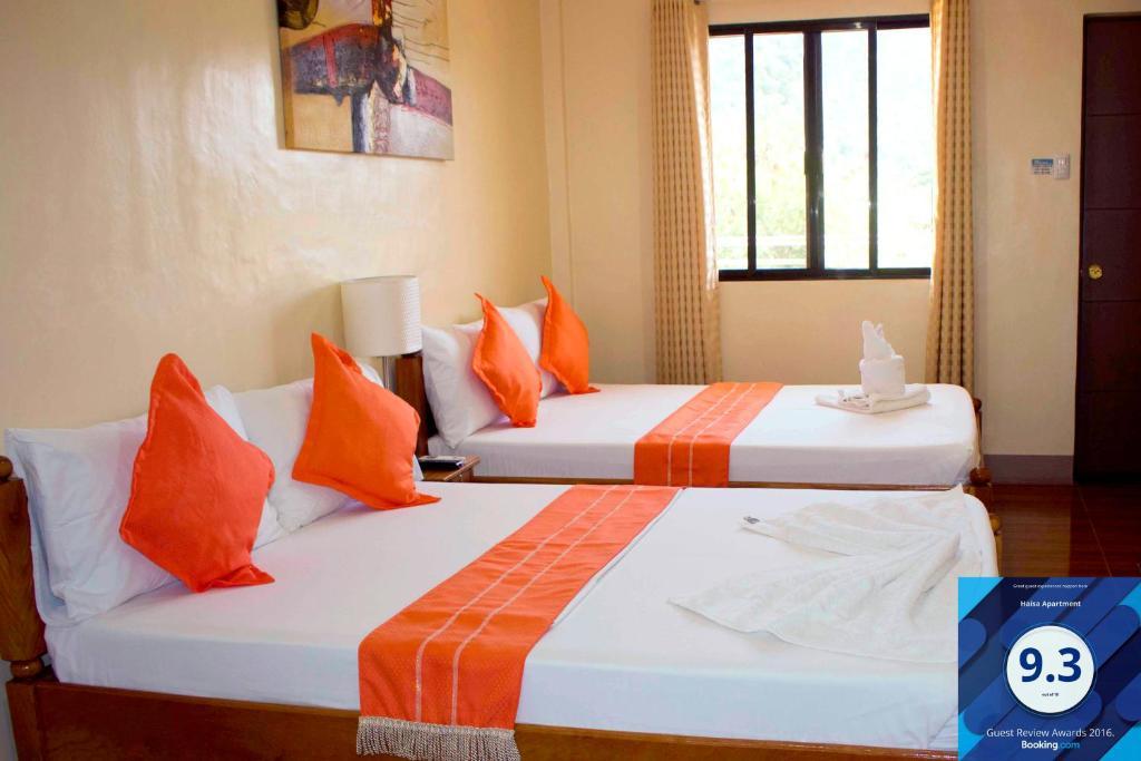 Cama ou camas em um quarto em Haisa Apartment