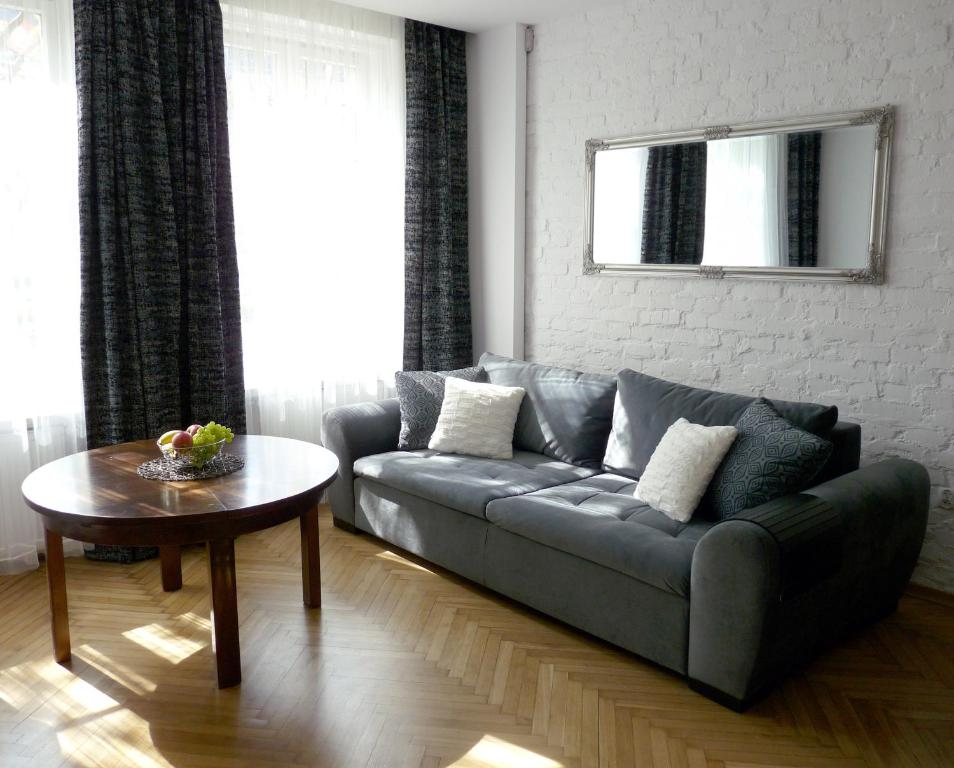 A seating area at Good Story Apartment Psie Budy