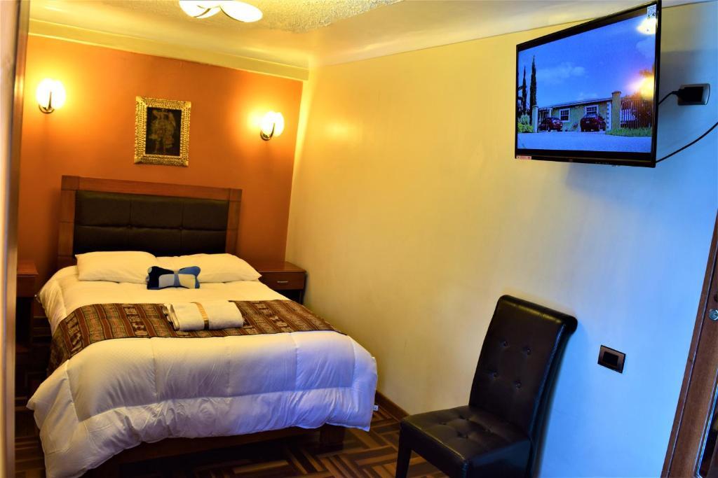 Cama o camas de una habitación en Cusco Golden Perú Inn