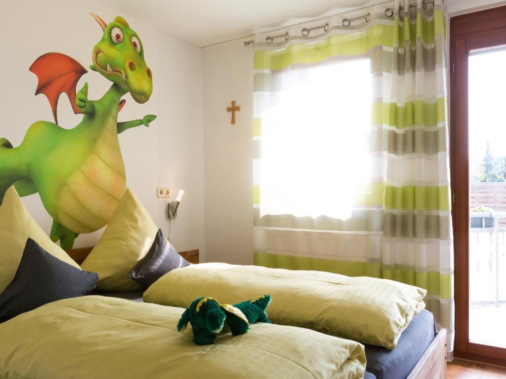 מיטה או מיטות בחדר ב-Ruster Drachennest