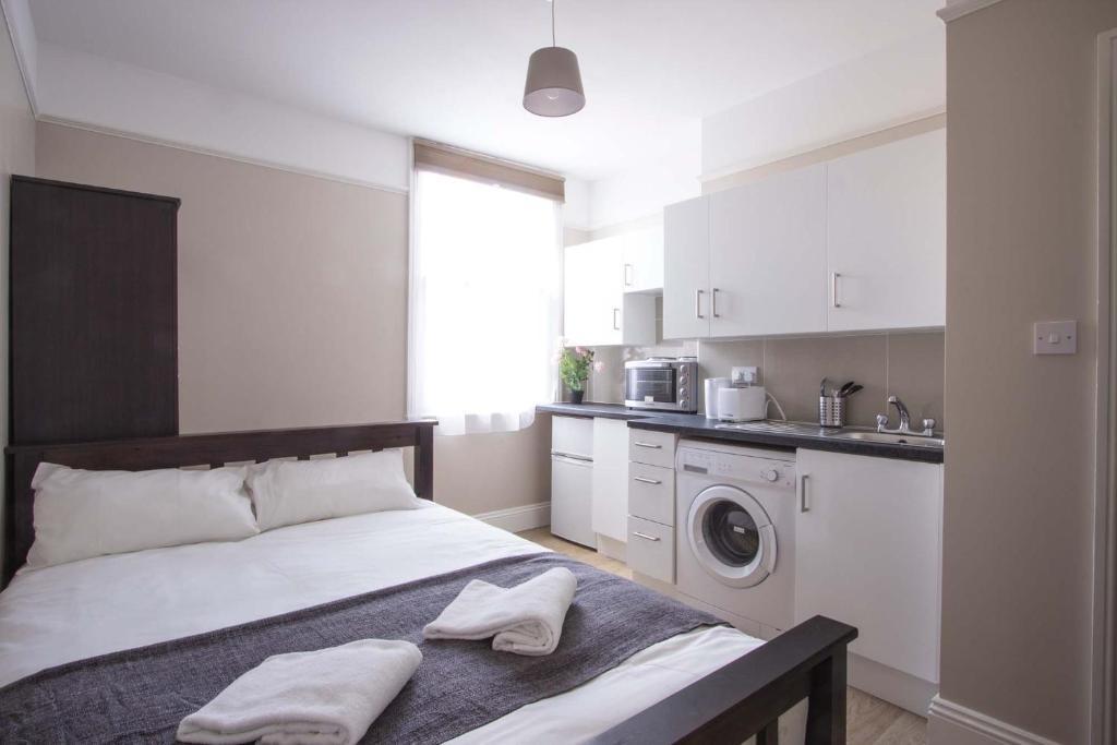 Kuchyňa alebo kuchynka v ubytovaní Mora Apartments