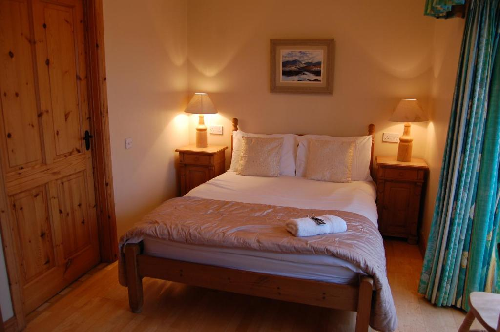 A bed or beds in a room at The Foxford Lodge, Bed & Breakfast