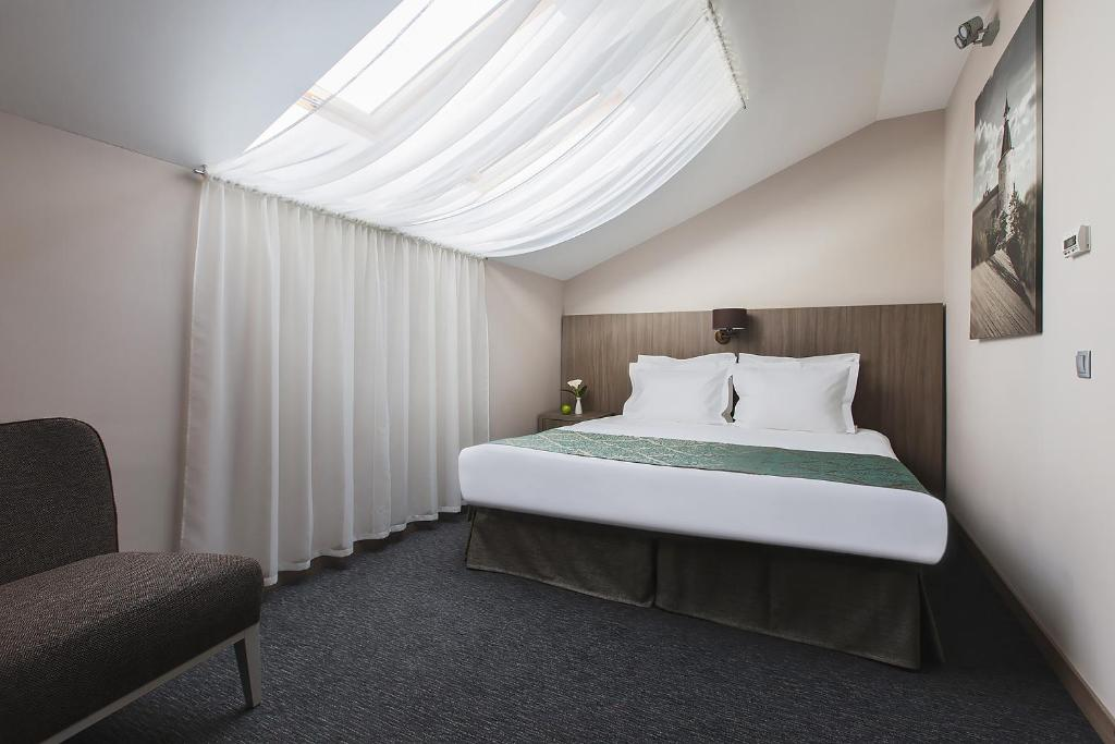 Кровать или кровати в номере Hotel Pokrovsky