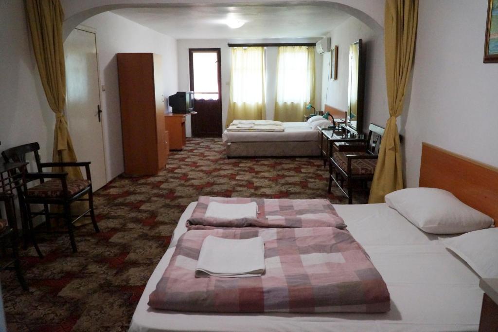 Postel nebo postele na pokoji v ubytování Guestrooms Roos