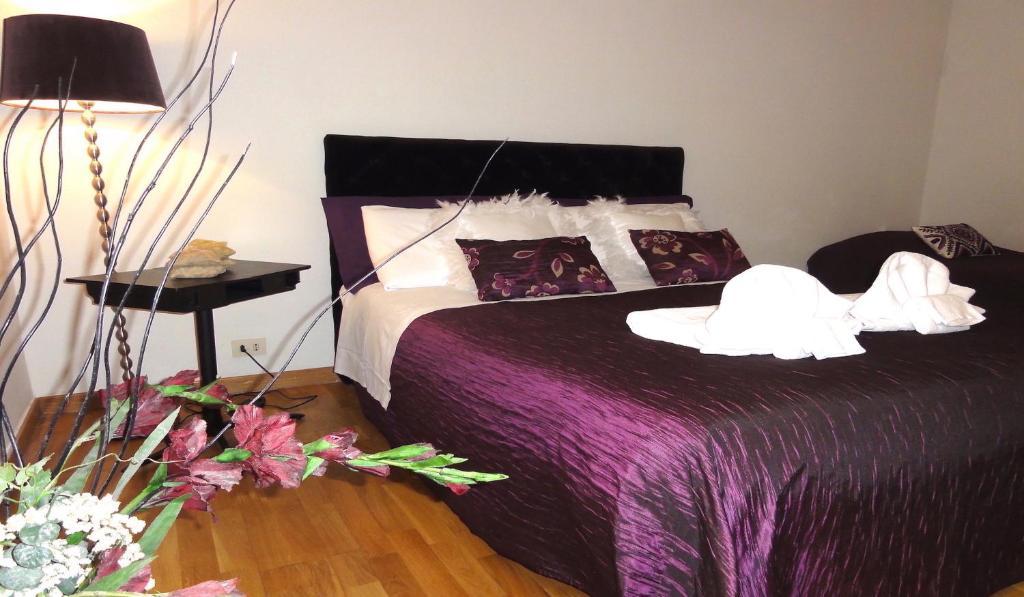 Un ou plusieurs lits dans un hébergement de l'établissement Locazione Turistica Navona - Victoria