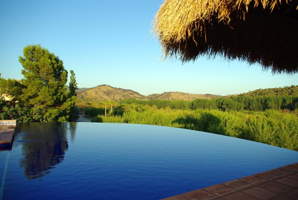 The swimming pool at or near Masía Durbá