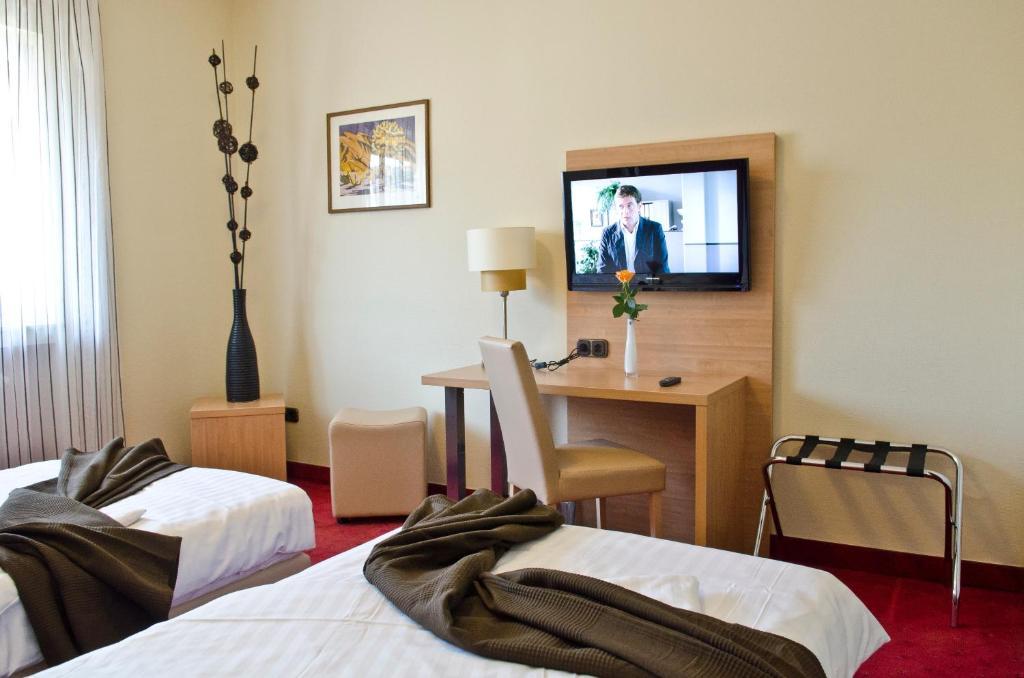 Ein Bett oder Betten in einem Zimmer der Unterkunft Hotel Paffhausen
