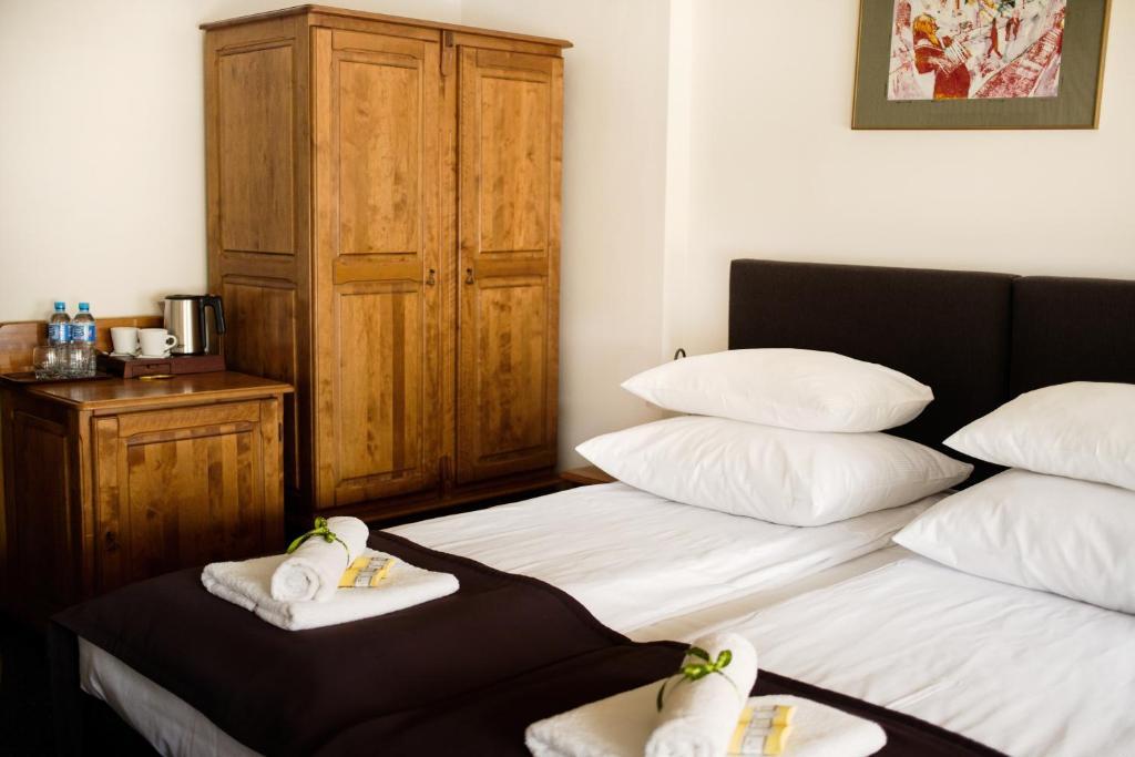 Lova arba lovos apgyvendinimo įstaigoje Hotel Eden