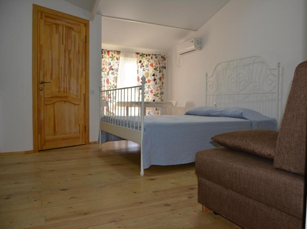 Кровать или кровати в номере Guest House Barabulka