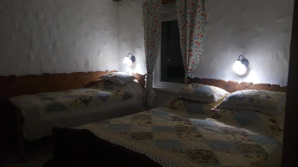 A bed or beds in a room at Гостевой дом Белая Дача