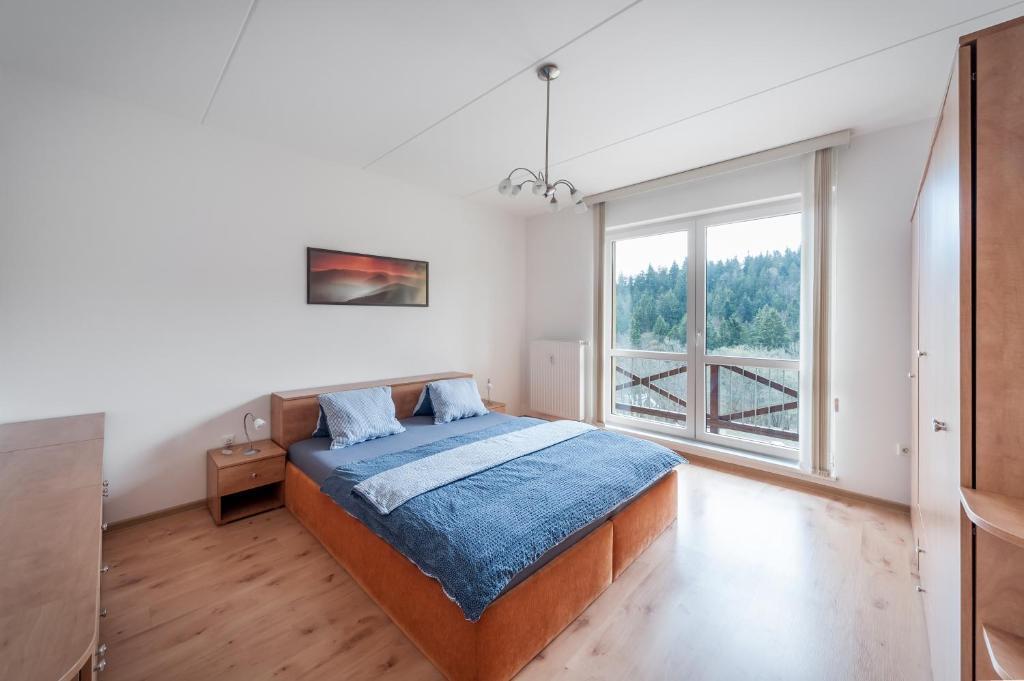 Postel nebo postele na pokoji v ubytování Apartmán U Lanovky