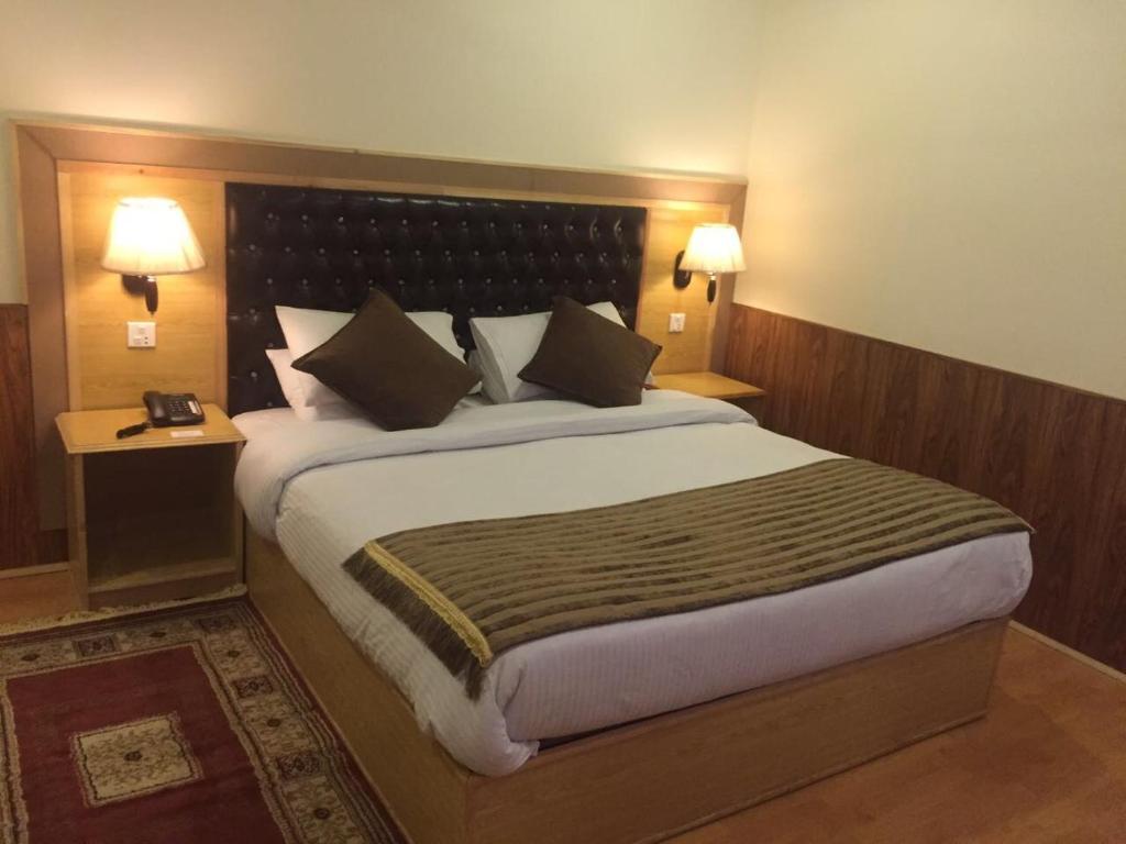A bed or beds in a room at Shangrila Resort Hotel Skardu