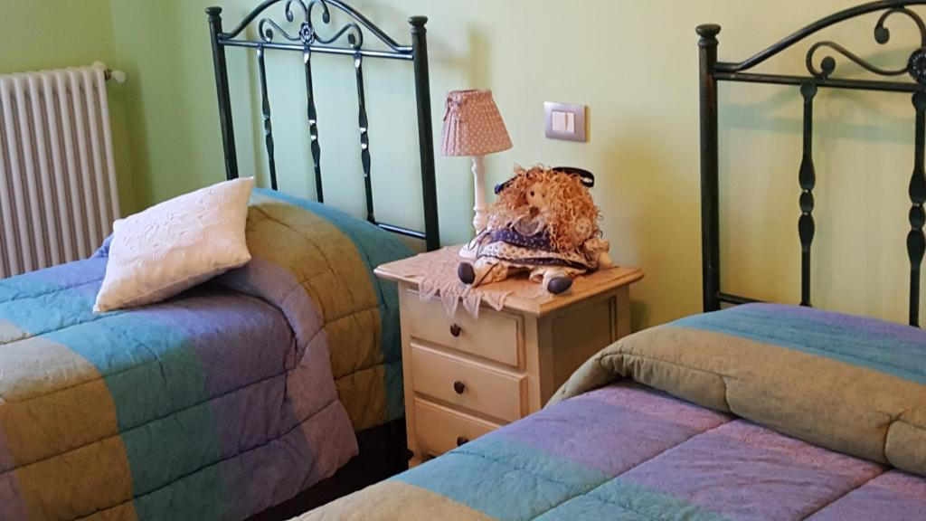 A bed or beds in a room at Residence Villa Valsi